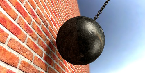 Wrecking-Ball-break-down-the-wall